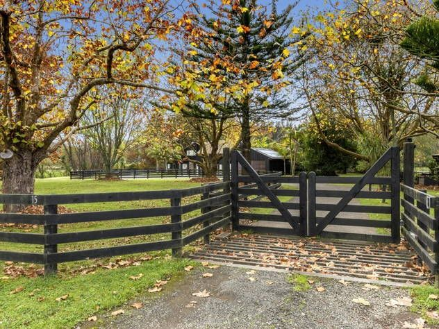 Look at this horsey, country, farm-style gate, driveway and trees, cattle-grid included! Rangitopuni Road, Coatesville, Auckland. So so pretty with the autumn leaves.