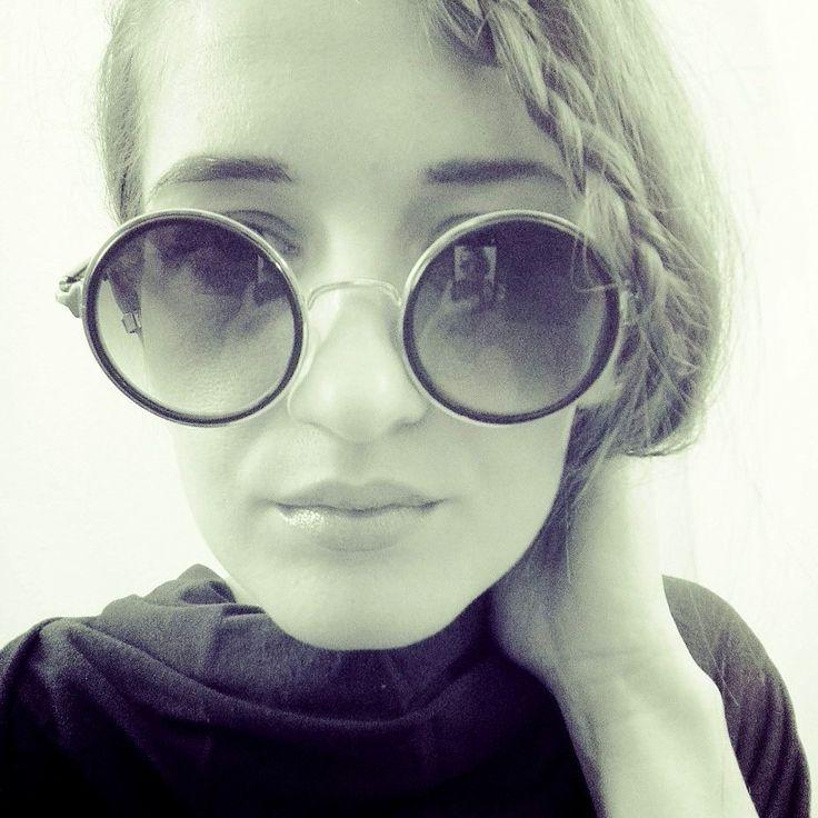 John Lennon sunglasses.