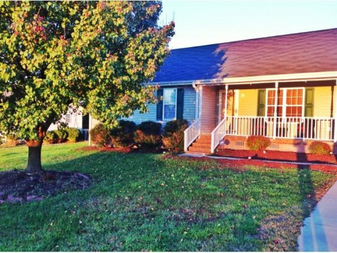 --Charming ranch home with rocking chair front porch with ...