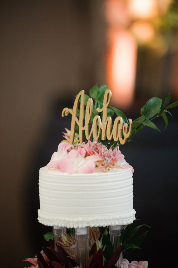 """www.psweddingsandevents.com  This listing is for 1 """"Aloha"""" cake topper made of 1/8"""" thick, recycled eucalyptus board. The cake toppers wording is approximately 7"""" wide and 4.5"""" tall. The stick to go into your cake is approximately 4.5"""" tall. This cake topper is available in: gold, gold glitter, sliver, silver glitter, rose gold, rose gold glitter, black and DIY (unpainted). If you order a painted cake topper it will come painted on both sides. We hand airbrush all of our products with no..."""
