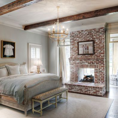 The double sided fireplace would only work if the other side was also in the bedroom as shown. It works as a nice divider here. I like the little dress framed over the bed- very sweet. And the wall color is very soothing. Nice French feel with the bed & chandelier.