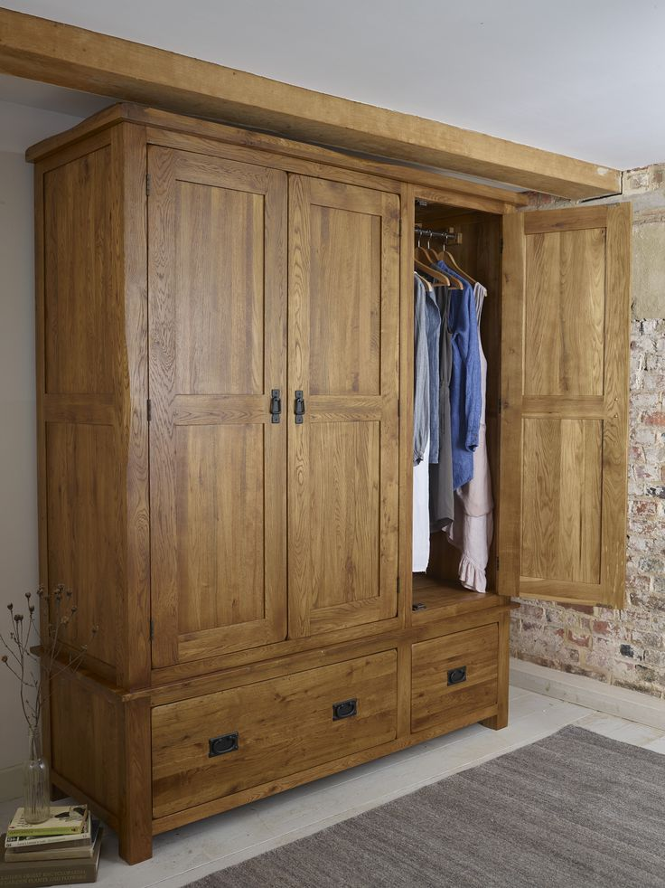 The Original Rustic Solid Oak Wardrobe is a stately and robust addition to a traditional bedroom. The whole Original Rustic Solid Oak collection is crafted by skilled joiners from only the highest grade oak and the wood is finished in a gently stained wax to create a rich, mature glow to the grain