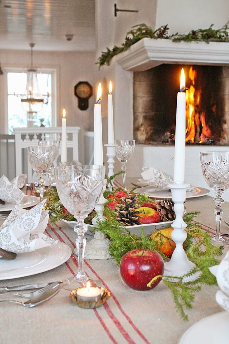 VIBEKE DESIGN- incorporate apples into centerpieces, stagger candles and invest in white candlesticks.