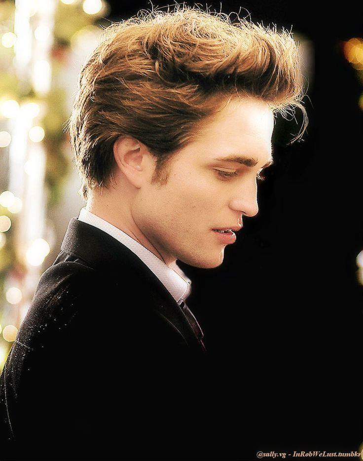 Edward Cullen (Robert Pattinson) ...shamelessly admitting he is my first book character I fell in love with...he is timeless :)