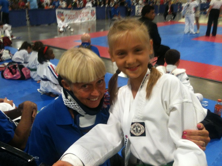 Abby waiting with Mrs. Jenni for her sparring competition to start at AAU Nationals in Ft Lauderdale, FL - July 2012