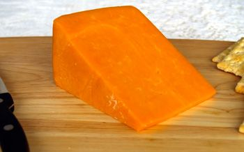 Red Leicester is a crumblier version of cheddar. Despite its flaky texture, it's still a firm cheese. The rind is reddish-orange with a powdery mould on it. http://www.cooksinfo.com/red-leicester-cheese