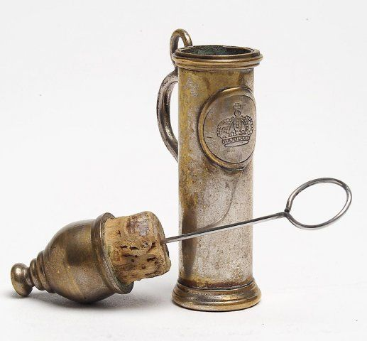 Smelling salts container. Worn by police to assist all those fainting ladies in corsets.