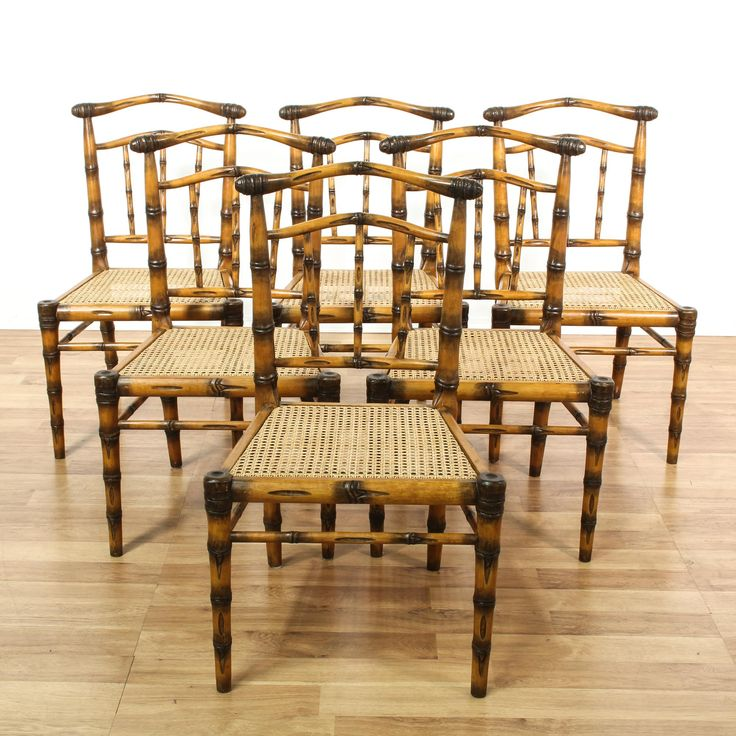 This set of 6 dining chairs are featured in a faux carved bamboo with a glossy finish. These tropical dining chairs are tapered legs, bent rail backs and woven cane seats. Unique chairs perfect for causal dining! #bohemian #chairs #diningchair #sandiegovintage #vintagefurniture