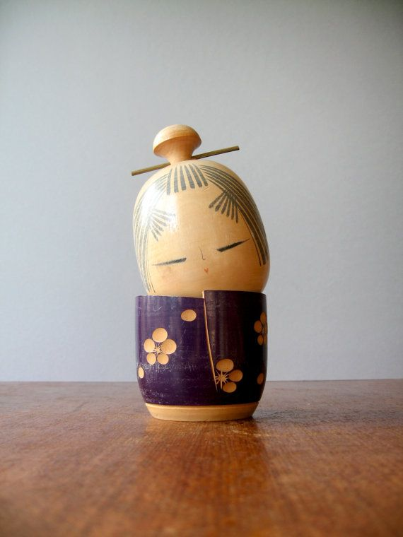 Large vintage Japanese kokeshi doll, designed attributed to Suigai Sato. She wears a brass pin in her hair. Has minor wear. In overall good vintage