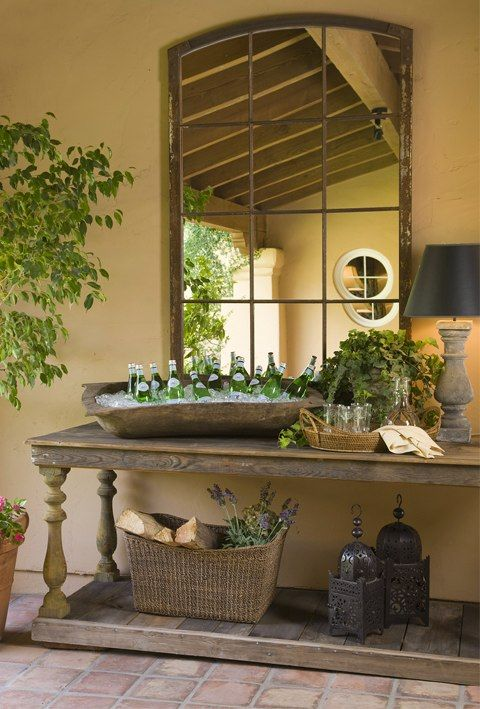 Beautiful outdoor room - console table is great for serving. The ficus tree adds a welcome touch of green & life.: