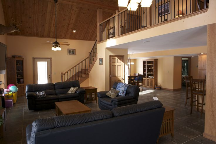 I like this floorplan with two-story living room with staircase walking down into it. Kitchen under loft. Dinner room under bedroom. Looks like could possibly also have main floor bedroom in back. High ceilings make it still look big but not massive.