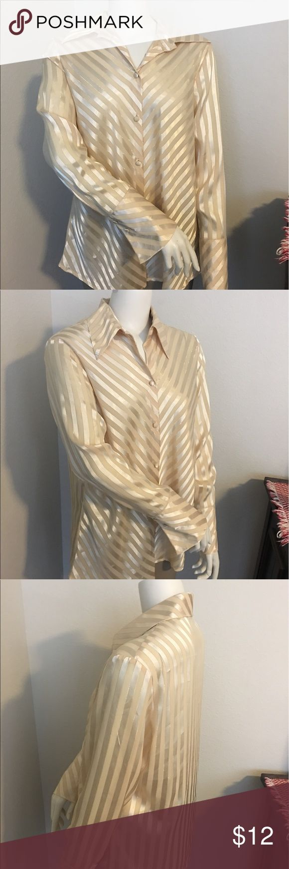 "Nygard womens gold LS button up/down shirt sz: 14 Thank you for viewing my listing, for sale is a women's, longsleeve, button up/down, gold striped, NYGARD Shirt/blouse.  Plus size, size 14.  If you have any questions or would like additional photos please feel free to ask.  From under one arm to under the other measures appx 23"" from the top of the shoulder to the bottom of the shirt measures appx 29"" NYGard Tops Button Down Shirts"