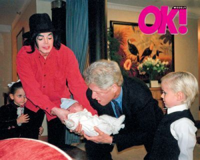 Michael Jackson with his daughter Paris (age 3) and son Prince (age 5) handing his new born son Blanket to Bill Clinton in February or March 2002.