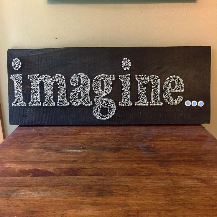 "This ""imagine"" string art is hand strung on 1 inch thick aged wood. We can do any words or states you want and more! We now sell on Etsy and can ship anywhere in the U.S."