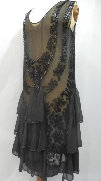 "Evening dress, ""Tango,"" ca. 1923. Beaded black chiffon, with yoke simulating a heavy necklace and medallion in jet beads. Chiffon panels flutter when the wearer dances."