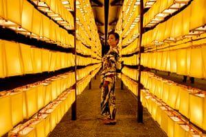 Tokyo, Japan A woman looks at rows of lanterns