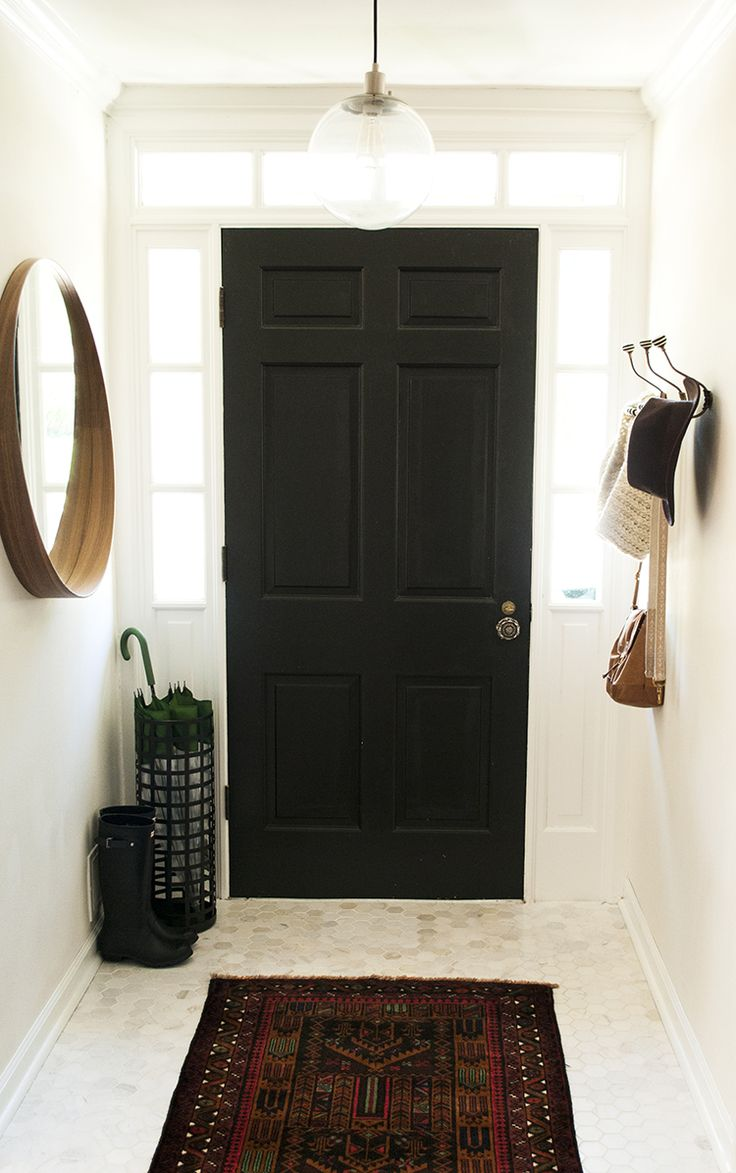 black door, marble hex, round mirror, side lights