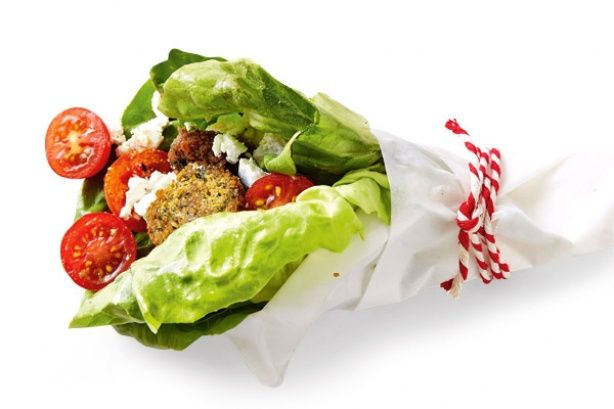 Falafel wrap - Place 2 large butter lettuce leaves on a piece of baking paper. Top with 3 halved cherry tomatoes, 2-3 halved falafel, and 2 tbs drained marinated feta. Use the paper to roll up the lettuce leaves. Secure with string.