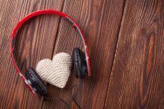 Heart toy with headphones stock photo