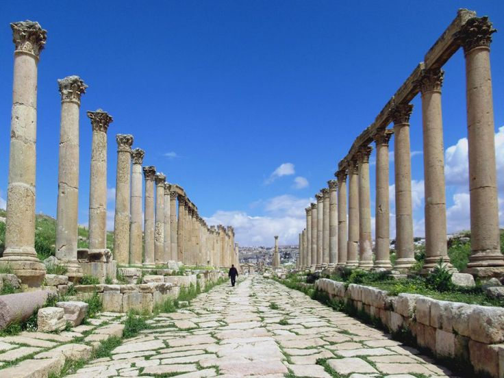 The colonnaded Cardo Maximus was the main street in the ancient Roman city of Jerash, Jordan. The ruts worn by chariots are still visible.