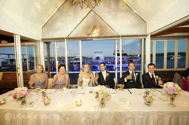 Bridal party table lined with the bide and bridesmaids bouquets. Classic wedding reception styling, ideas and inspiration.  Reception Venue: Mosman's Restaurant  Photography by DeRay & Simcoe