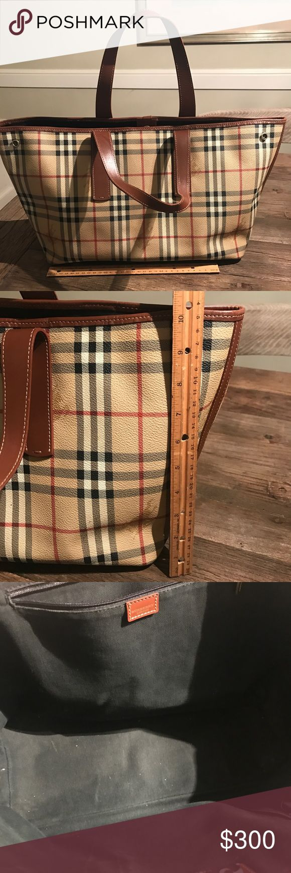 Burberry Medium Tote Circa 2005 and I used this as a diaper bag when my son was a baby. Burberry checked bag in very good condition. Some marks but nothing noticeable. Handles in very good shape. This bag has been in my closet for 12 years! Authentic and clean! Make me an offer! Burberry Bags Totes