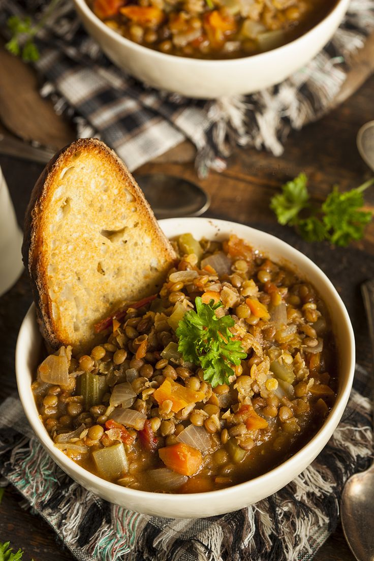 Italian Lentil Soup {Zuppa di Lenticchie} | Girl Raised in the South. Ingredients: olive oil, onion, carrot, celery, garlic, tomatoes, potatoes, vegetable stock, lentils, parsley, rosemary, bay leaf, s and p