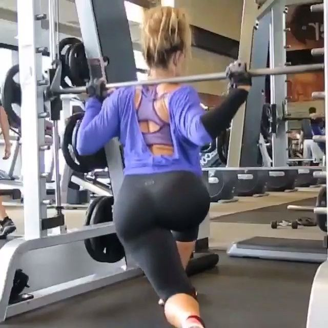 Smith machine curtsey lunge with knee up. Bend knees and drop like you would a regular lunge, but instead bring back leg to the opposite side - like a curtsey. As you lift leg back up, squeeze core and lift knew to chest . Repeat for full set and switch legs . -  Hashtag #Gym_videos and @ us in your captions for a possible feature.  IG|@leanmachine21
