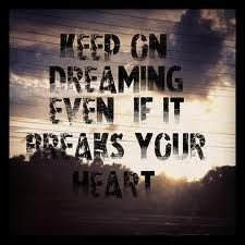 """oh, I can hear 'em playin' I can hear the ringin' of a beat up ole' guitar oh, I can hear 'em singing, """"Keep on dreaming, even if it breaks your heart."""""""