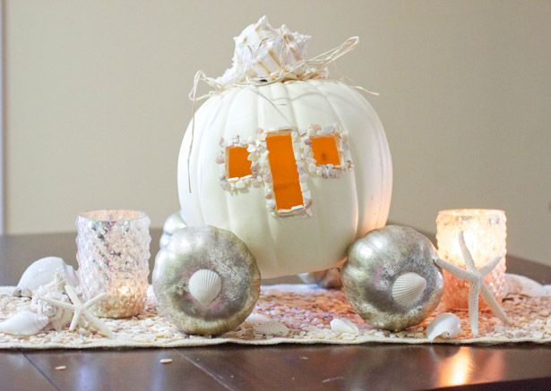 A white pumpkin fairy tale carriage using seashells.