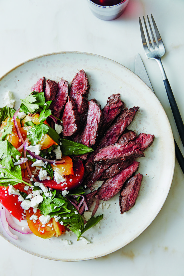 Herb-Marinated Grilled Steak | Recipe from 'Plated' | If there's anyone who can help you get a quick, flavorful dinner on the table with ease, it's Elana Karp and Suzanne Dumaine, members of the culinary team at the meal kit delivery service Plated. This marinated steak with a simple tomato and feta Mediterranean salad fits the bill perfectly.