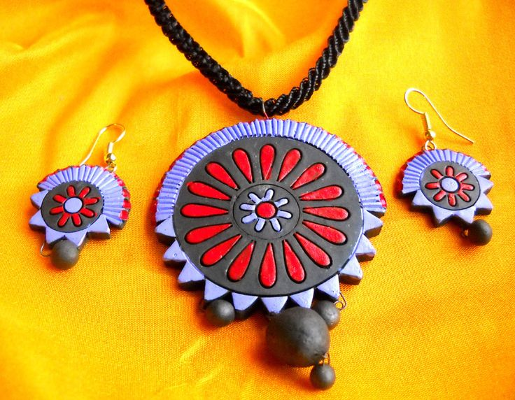 Pretty as a daisy, fluttering in the wind, try this simple yet sophisticated terracotta pendant and earrings set.