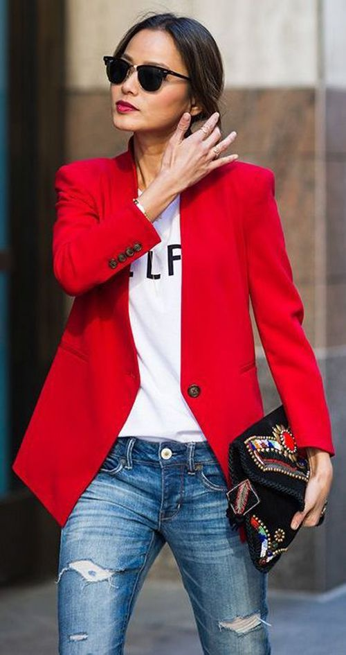 Red thin comfortable blazer, white tee w blk lettering, distressed jeans, black w red detailing clutch.