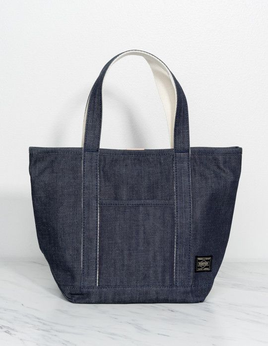 Porter x Orgabits Denim Tote Bag This Porter miniature denim tote is crafted from 100% organic cotton with reversible construction, dual carrying handles, contrast leather accent at top, and single ex