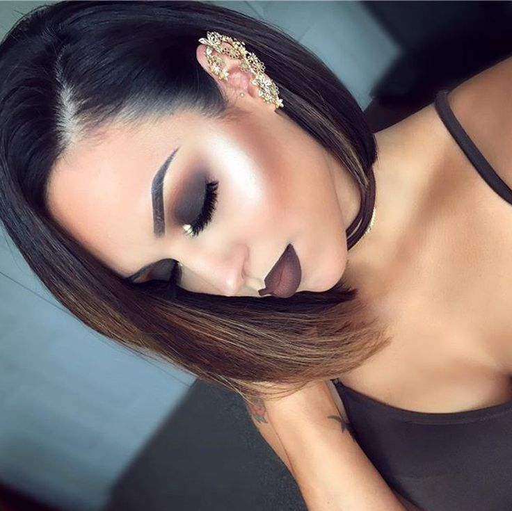 I like the makeup look but the point of contour is to make it look like you got defined cheek bones lol not dark ass cheek bones other than that she slayed the look!