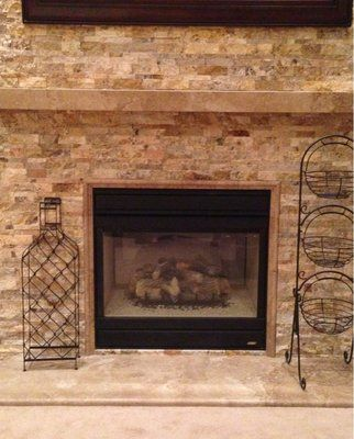Focal wall showing Noce Travertine mantle and matching ...