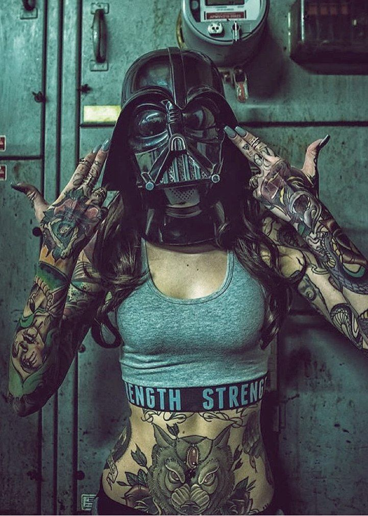 i like the wolf tattoo and the tattoo of the oozing woman (idk what to call it) on her right arm, but what's up with the vader mask? Hmm.. Is this a meme thing I am in the dark of (as it is with me and many meme things cuz i live in a box) Or maybe they are shy or something...