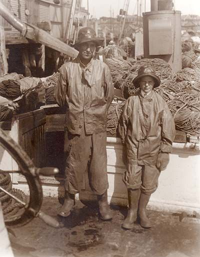 Gloucester fishermen  sepia  kid hat uniform rope boat, and wearing a knitted Guernsey underneath without a doubt!