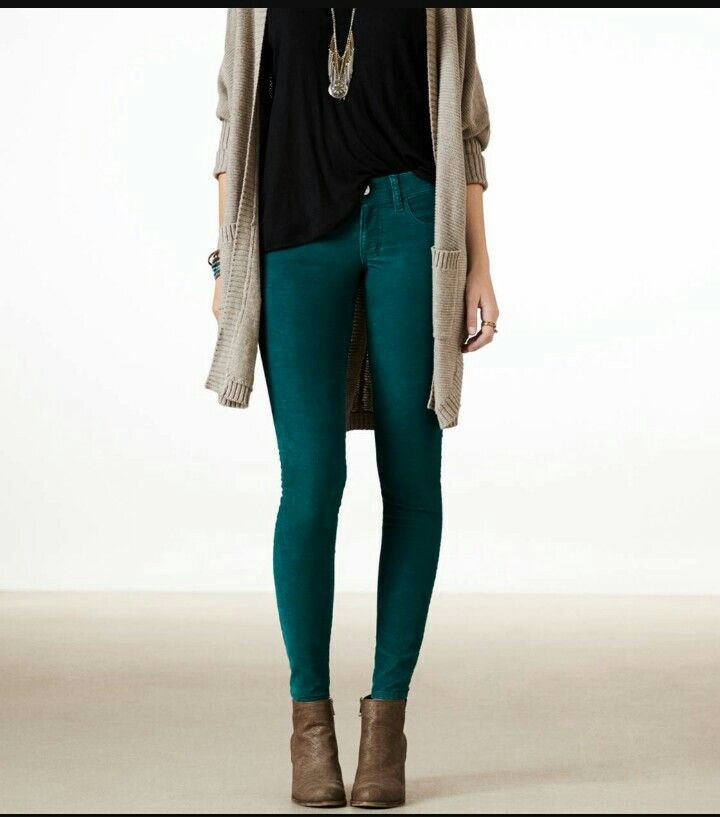 Teal pants, black top, beige sweater, boots