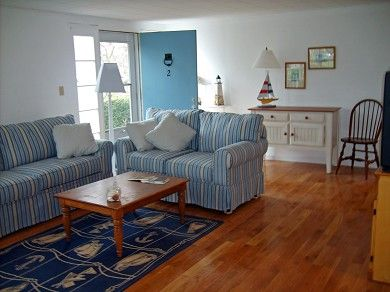 such a beachy living room in this falmouth vacation rental