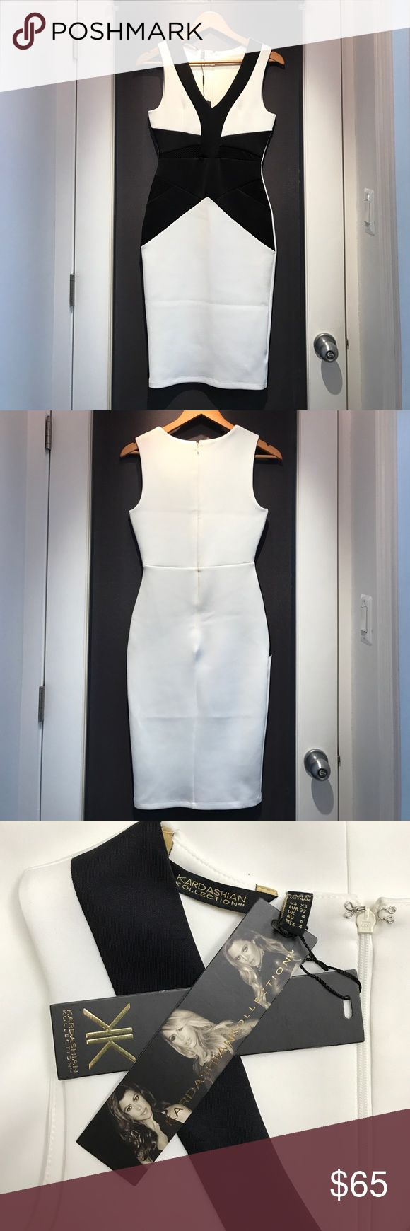 Black and white Kardashian Kollection dress Stunning black and white size XS Kardashian Kollection dress. Never worn! Kardashian Kollection Dresses Midi