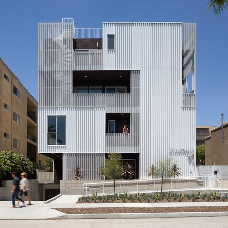 Cloverdale749 apartments by LOHA feature balconies screened by perforated metal panels