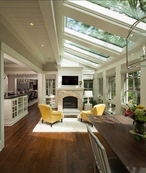 a breakfast room / sunroom with lots of big skylights