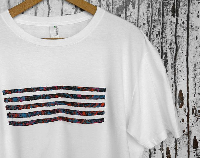 Hand-painted white t-shirt, with black, fluo pink, orange and electric blue abstract painting. 100% quality organic cotton. € 19,90