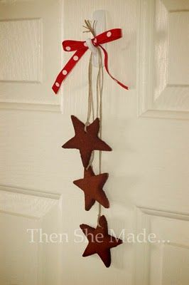 """Then she made...: Cinnamon Applesauce Ornaments. Note: make sure that you do not roll out the """"dough"""" too thin.  I did this and they broke as I took them off the baking sheet with a spatula."""