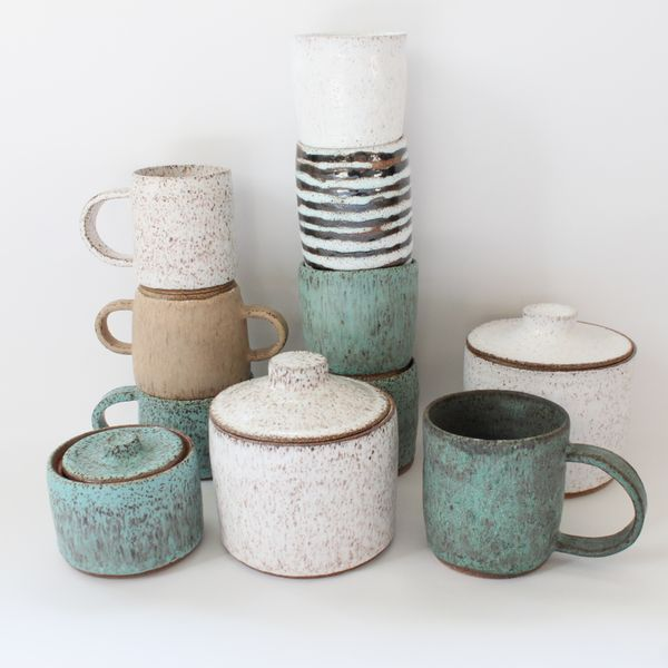 Stoneware glazes, speckled finish, wheel thrown, slab constructed handles, i like the finish and the lids