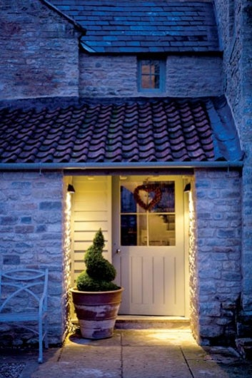 nighttime entry with barrel tile and faded stone bricks