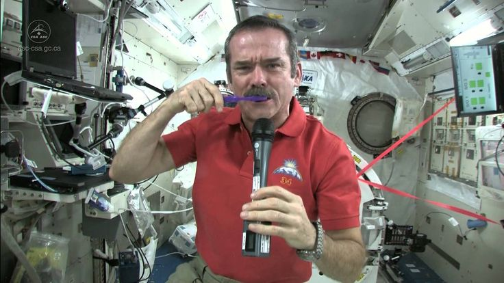 """Chris Hadfield Brushes his Teeth in Space - There is also a video of """"crying"""" in space....with interesting results."""