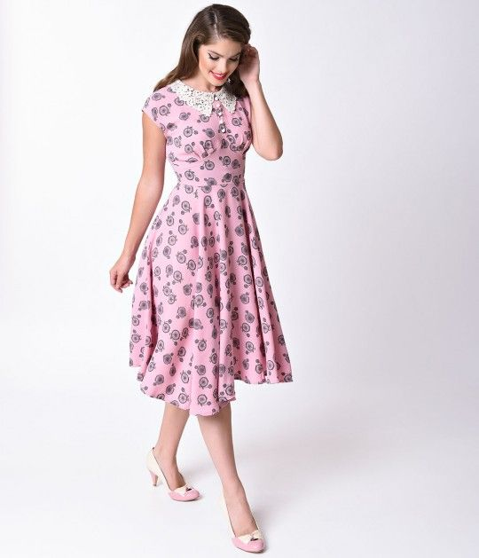 Penny for your thoughts? A beautiful soft pink swing fresh from Hell Bunny, the Penny Lover dress is structured in a superbly textured crepe fabric and cast in a sensible Pin-up silhouette, smattered in a charming Penny Farthing bicycle print! The dainty