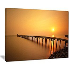 Orange wall art is the perfect type of fall wall art to use  in your home. In fact fall canvas art is  especially trendy this time of year.  Whether it be an orange wall clock, orange canvas art or even orange  wall hangings you will find something perfect to decorate your home for  #autumn.       Design Art Old Wooden Pier Long to Evening Sea Sea Pier and Bridge Wall Art Canvas, 20x12